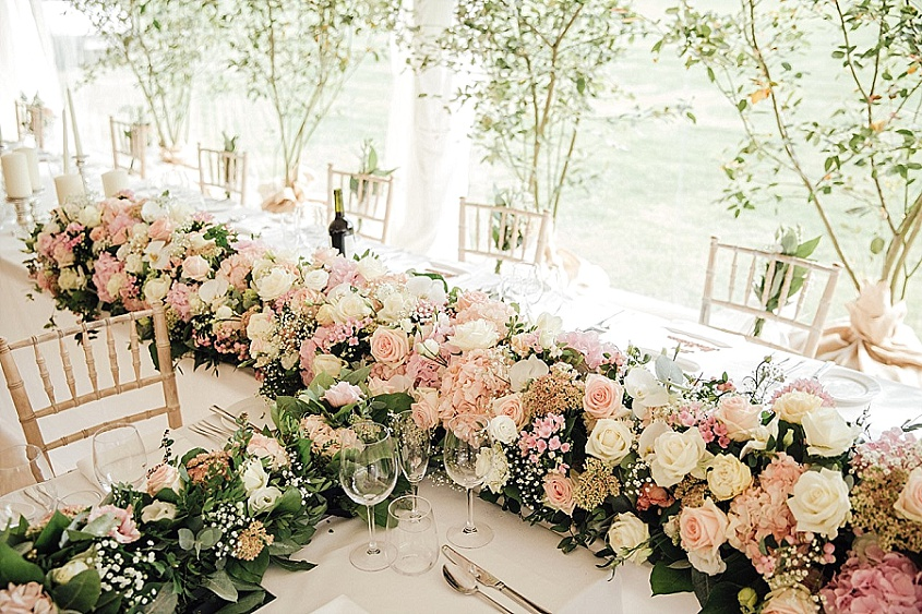 When you picture your wedding flowers, what do you see? A modest bouquet and some buttonholes? A handful of vases filled with pretty blooms? Or maybe your imagination runs wild and you dream of filling your wedding with as many blooms as possible?